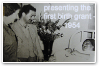 presenting the first birth grant - 1954